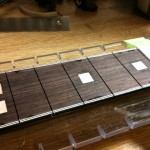glued down, recutting fret slots