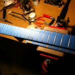 Frets masked for polishing