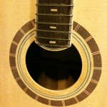 Fretboard and soundhole