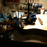 Fretboard extension being glued to body